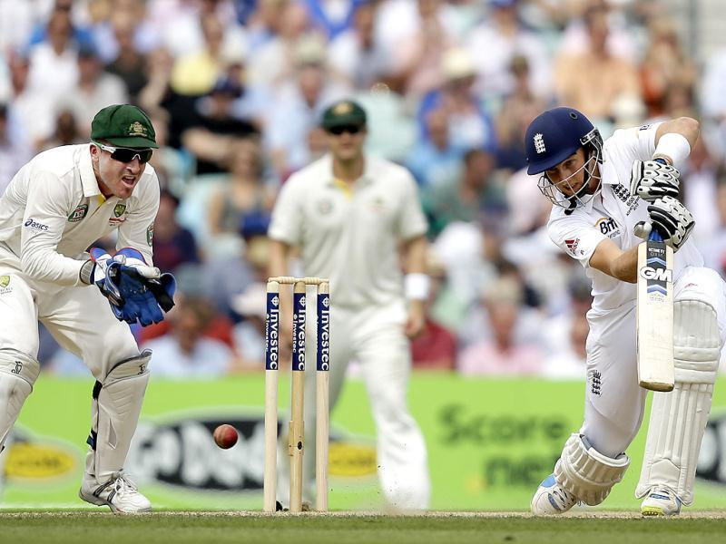 England's Joe Root plays a shot off the bowling of Australia's Nathan Lyon during play on the third day of the fifth Ashes Test at The Oval in London. (AP Photo)
