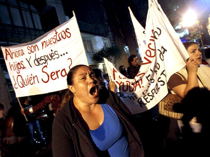 A relative of one of 12 people abducted in May yells outside a club called Heaven in Mexico City. Reuters photo