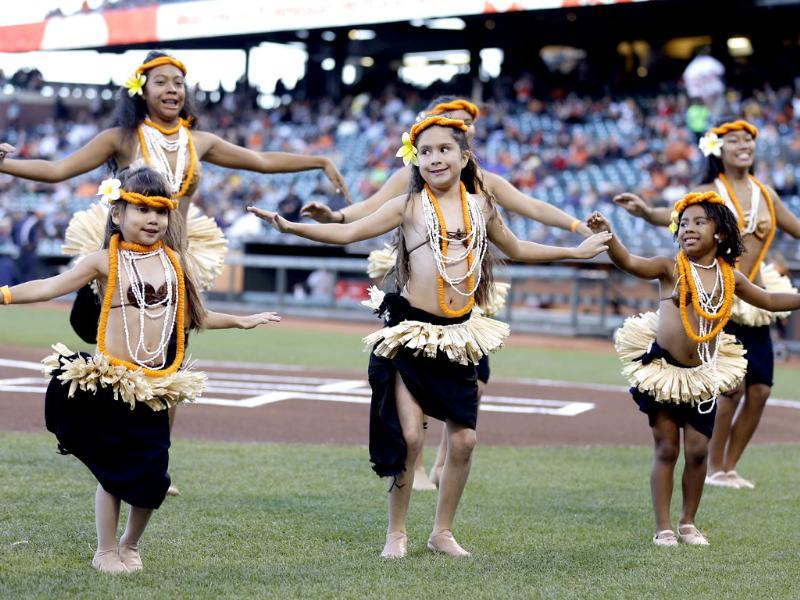 A group of dancers with the group Ehulani Otea perform during a tribute to Polynesian Heritage Night before the start of a baseball game between the San Francisco Giants and the Pittsburgh Pirates in San Francisco. AP photo
