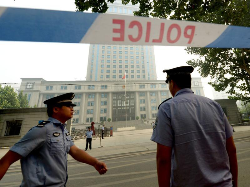 Police stand guard during the third day of the trial of disgraced politician Bo Xilai at the Intermediate People's Court in Jinan, Shandong Province. AFP photo