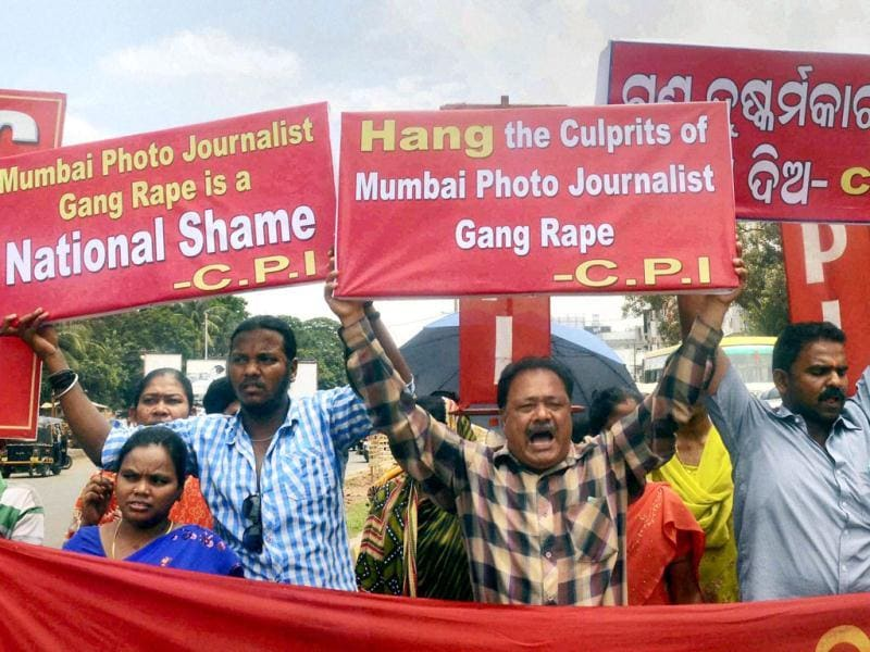 CPI activists take out a rally to protest against the rape of a Mumbai photojournalist, in Bhubaneswar. (PTI Photo)