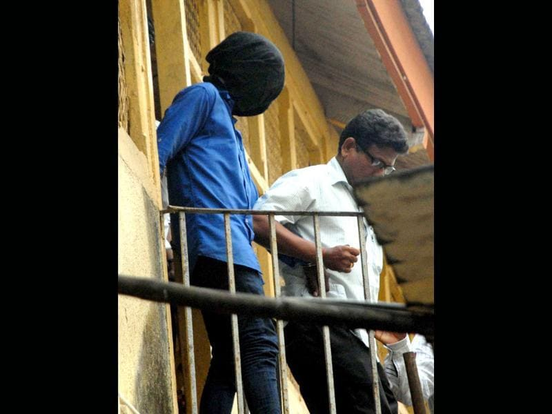 An accused in the Mumbai gang rape of August 22 being produced in a court in Mumbai on Saturday. (PTI Photo)