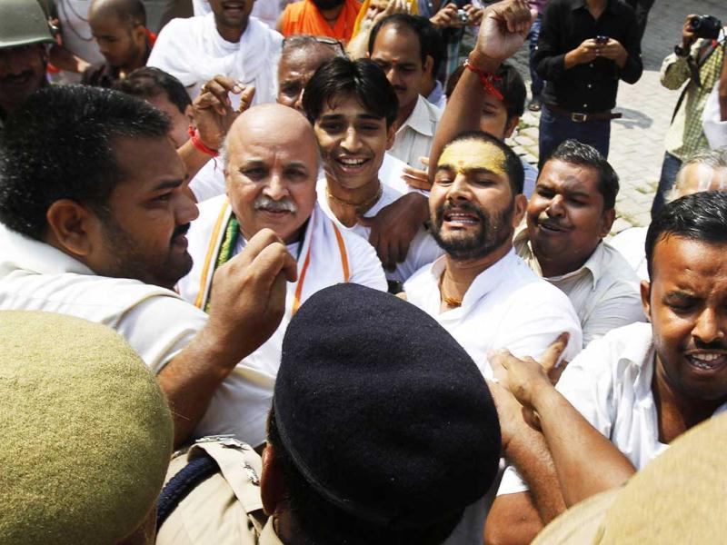 Activists of the Vishwa Hindu Parishad (VHP) scuffle with policemen before getting detained at Ayodhya. Policemen detained more than 500 VHP activists as they tried to take out religious procession, which aims at expediting the movement for construction of the Ram Temple in Ayodhya. (AP Photo)