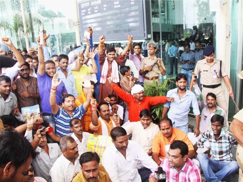 VHP workers protesting at Lucknow airport after VHP chief Ashok Singhal was taken into custody. PTI Photo
