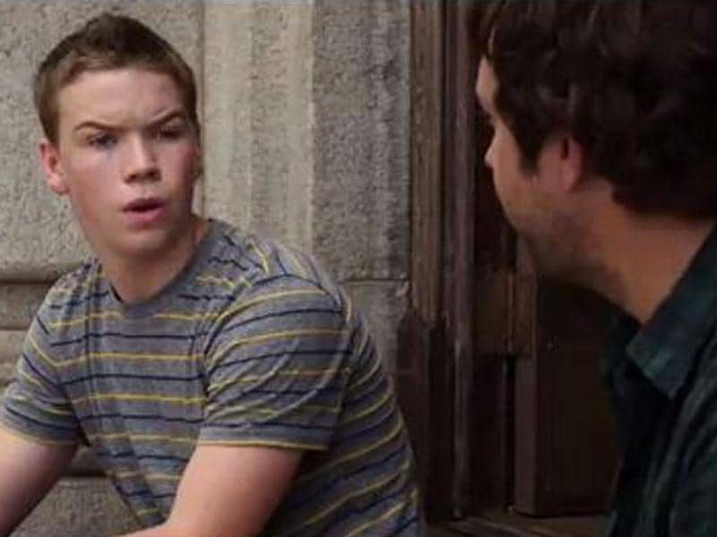 Will Poulter strikes a classic Poulter expression.
