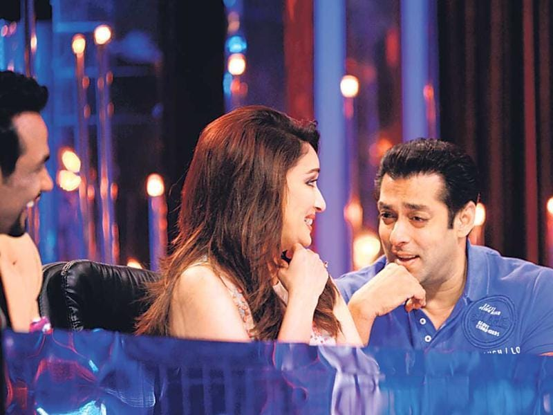 Salman Khan seems to be saying to madhuri Dixit: Its been 19 years since Hum Aapke Hain Kaun and you still look exactly the same!
