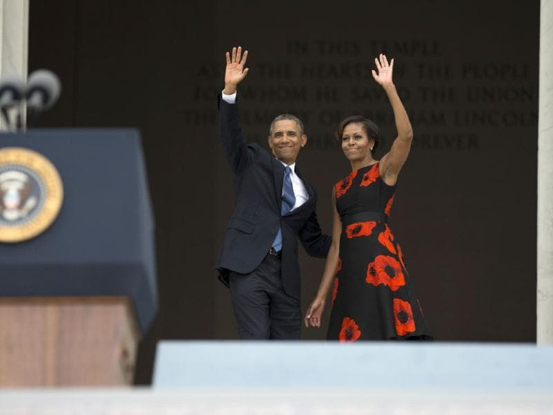 President Barack Obama and first lady Michelle Obama wave to the crowd after the ceremony at the Lincoln Memorial in Washington.(AP Photo)