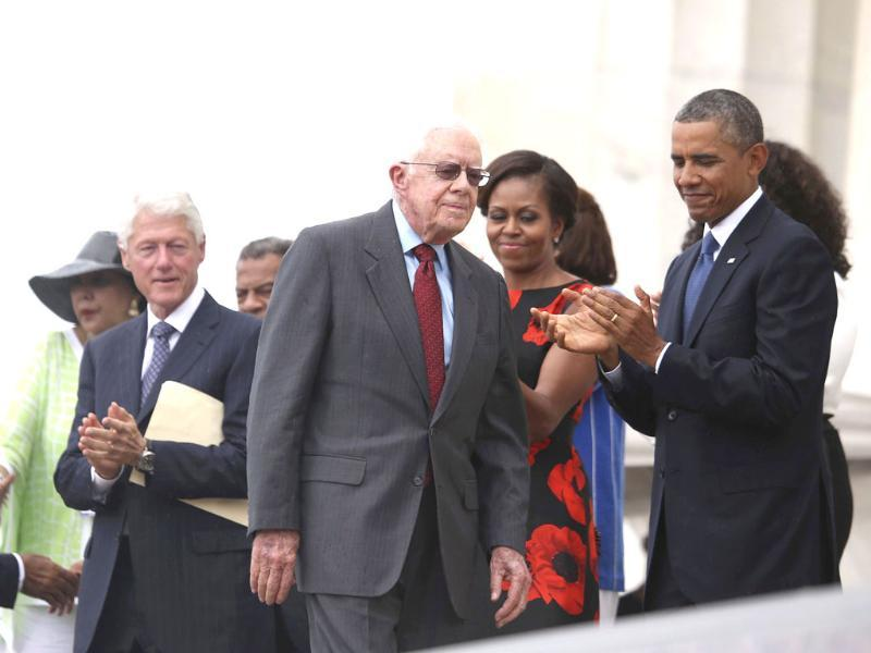 Former President Jimmy Carter walks to deliver a talk as President Obama applauds during the 'Let Freedom Ring' ceremony in Washington. (Agencies Photo)