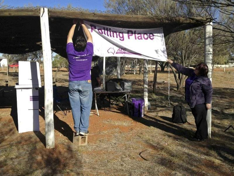 Polling officials erect a mobile polling station at the outstation of Artekerre, located around 50kms (31 miles) north of Alice Springs in Australia's Northern Territory. (Reuters Photo)