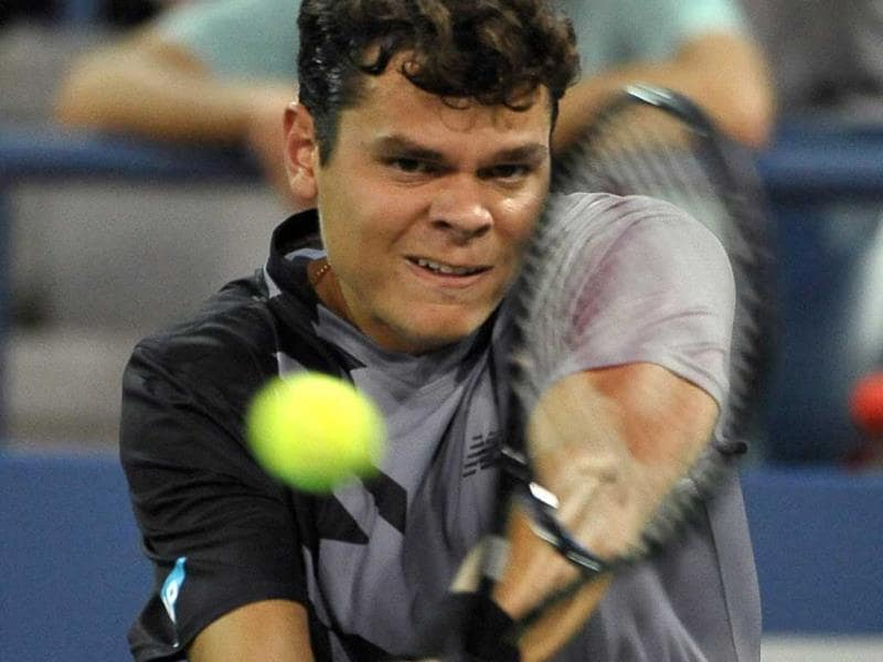 Milos Raonic of Canada fires a backhand return against Pablo Andujar of Spain at the US Open in New York. (AP Photo)