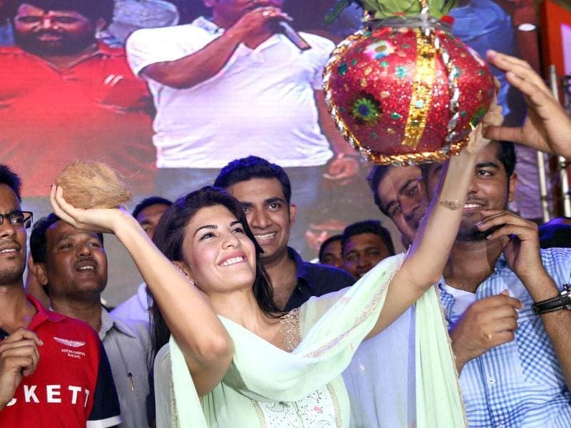 Bollywood Actress Jacqueline Fernandez breaking a dahi-handi in Thane on Thursday. (PTI Photo )