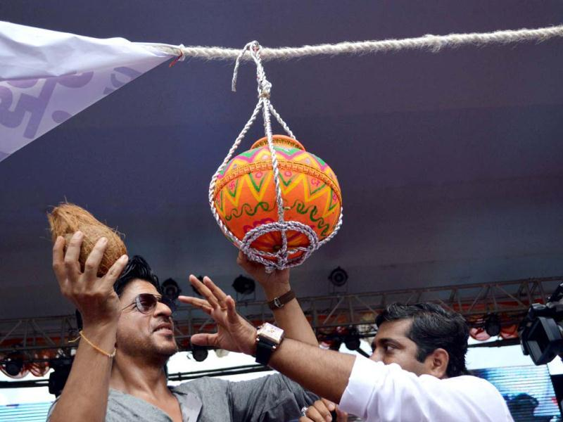 Actor Shah Rukh Khan is about to break the pot during Dahi handi celebrations.