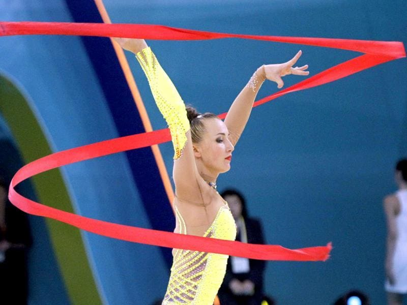 Ganna Rizatdinova of Ukraine performs with a ribbon, during the 32nd rhythmic gymnastics world championships in Kiev, Ukraine. AP Photo