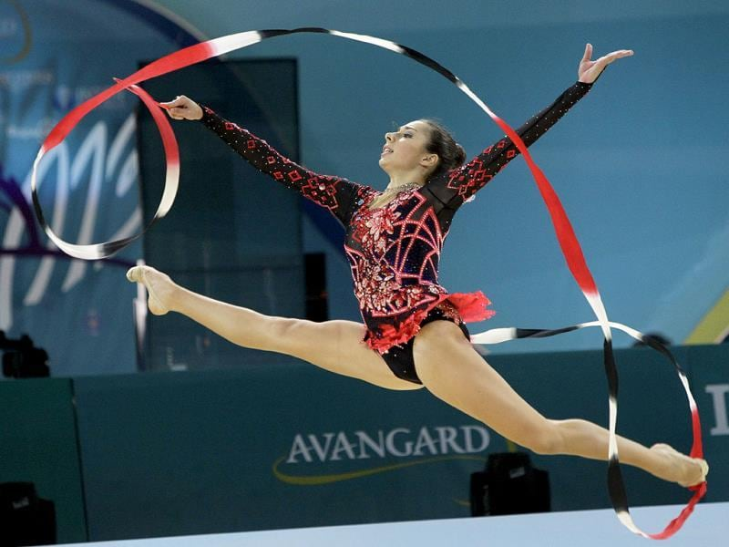 Rebecca Sereda of USA perform with ribbon during the 32nd rhythmic gymnastics world championships in Kiev, Ukraine. AP Photo