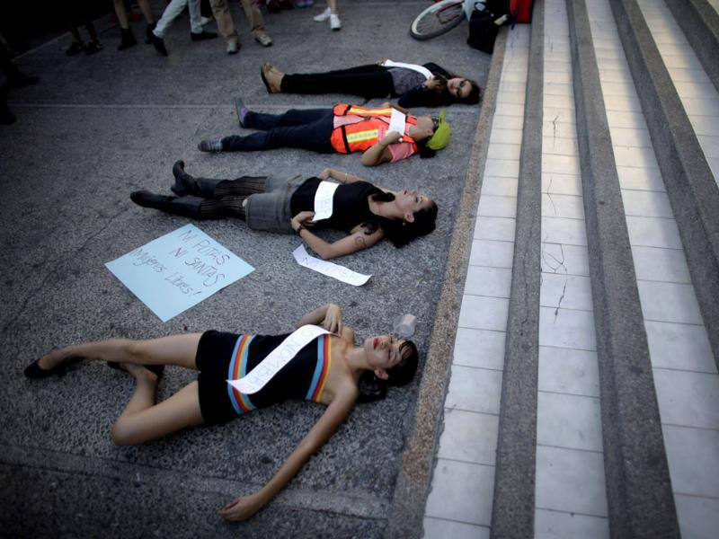Activists protest against discrimination and violence against women in Monterrey, Canada. (Reuters Photo)