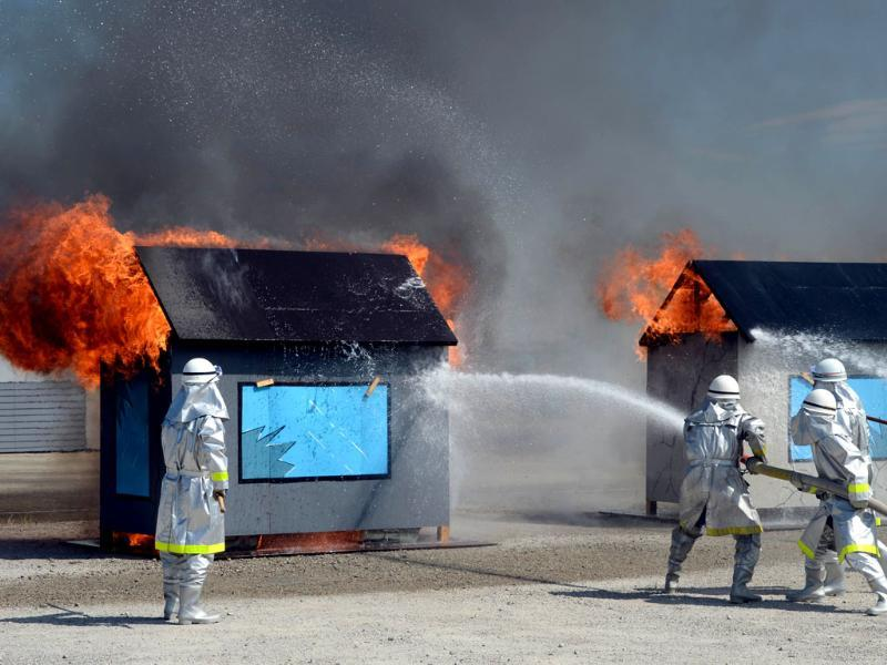 Firefighters spray water to put out flames during a joint disaster prevention drill in Chiba, Tokyo. (AFP Photo)