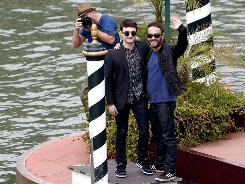 Radcliffe and Krokidas wave at everyone.