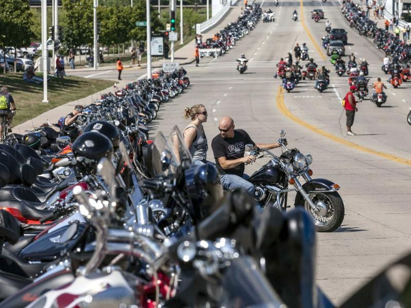 A Harley rider finds a parking spot on the street near the Harley-Davidson Museum for the company's 110th anniversary celebration in Milwaukee, Wisconsin (Reuters Photo)