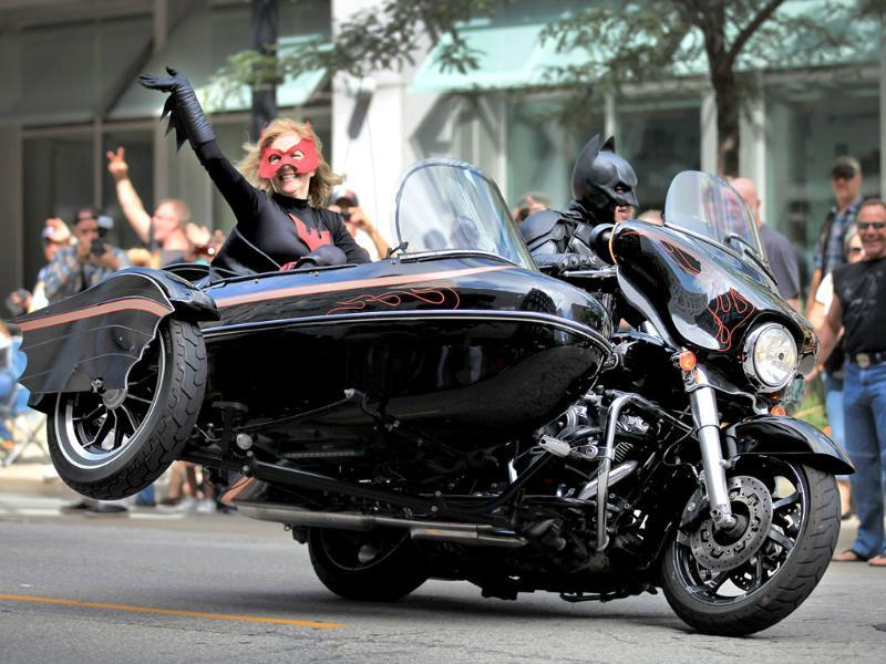 A Batman-themed Harley-Davidson rider gets his side car off the ground along Wisconsin Avenue during the Harley-Davidson 110th Anniversary Parade in Milwaukee, Wisconsin (Reuters Photo)