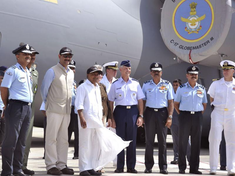 Defence minister AK Antony, IAF chief NAK Browne and other officials stepping out of Globemaster C-17 aircraft at Hindon air base in Ghaziabad. (Sakib Ali/Hindustan)