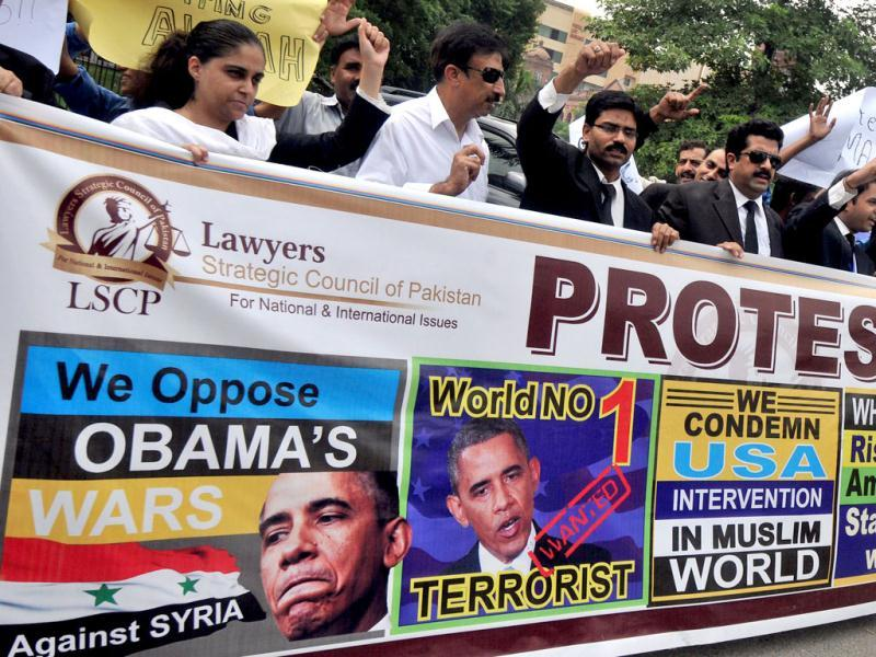 Lawyers shout anti-US slogans against a possible US attack on Syria during a protest in Lahore. AFP photo