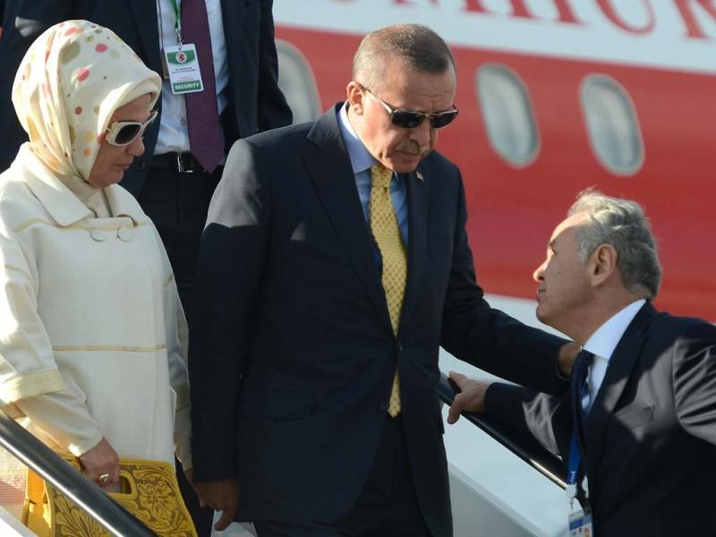 Turkey's Prime Minister Recep Tayyip Erdogan (C) and his wife Emine get off the plane after arriving at Saint Petersburg airport ahead of the G20 Summit. (AFP Photo)