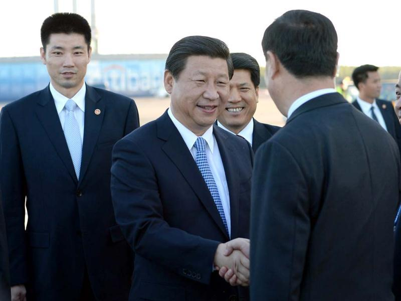 China's President Xi Jinping, (2nd L), arrives in St Petersburg, Russia. (AP Photo)