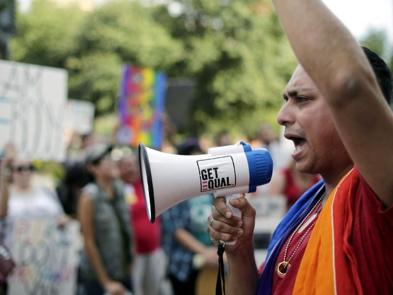 Supporters of a proposed ordinance prohibiting discrimination based on sexual orientation and gender identity rally outside the city council chambers in San Antonio, Texas. (AP Photo)