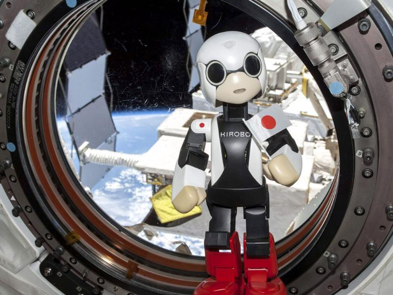 Humanoid communication robot Kirobo holds a Japanese national flag as it speaks a message, during a session to check the success of its first conveyance into space, at the International Space Station. (Reuters Photo)