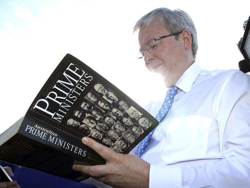 Australian PM Kevin Rudd signs a book at The Entrance, Australia. AP photo