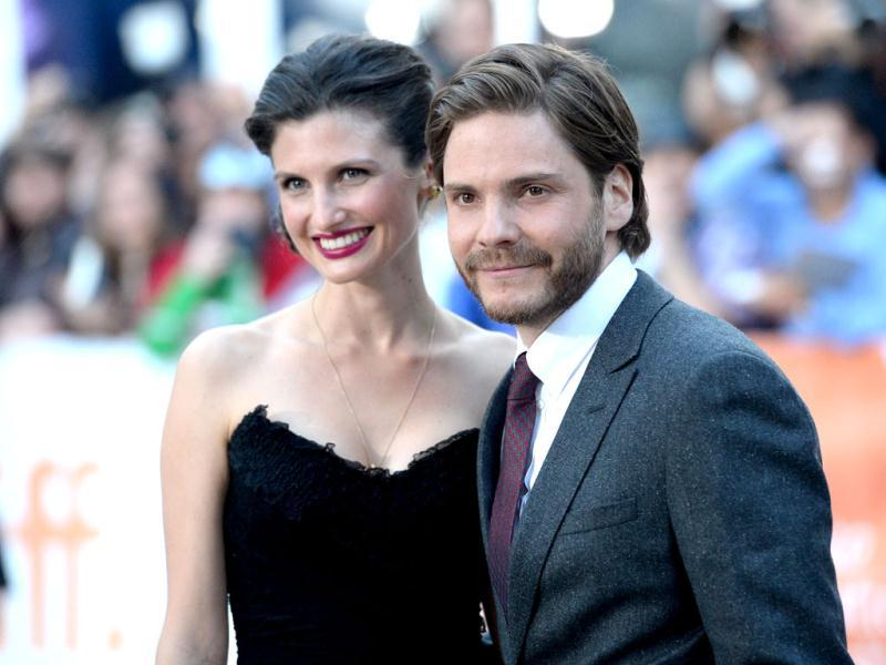 Actor Daniel Brühl and Felicitas Rombold arrive at The Fifth Estate premiere during the 2013 Toronto International Film Festival in Toronto, Canada. AFP photo