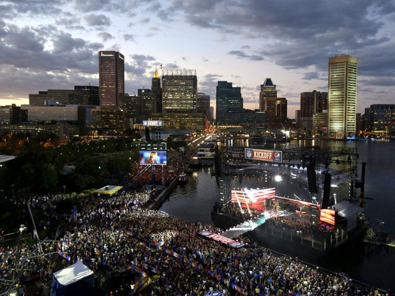 Keith Urban performs on a stage floating in Baltimore's Inner Harbor during an NFL Kickoff event to celebrate the season-opening NFL football game between the Baltimore Ravens and the Denver Broncos in Denver. AP photo