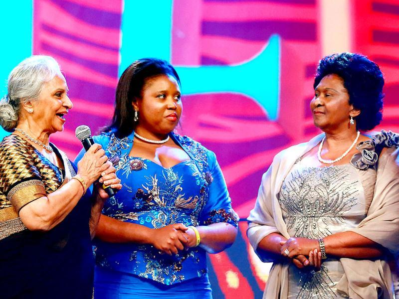 Waheeda Rehman, Zulu Princess Mukelile Zulu, Zulu Queen Ma Ndlovu hand over the Special Madiba award to Nelson Mandela's grandaughter Ndileka Mandela during the first cross cultural awards ceremony the 2013 South Africa India Film and Television Awards in Durban. AFP photo