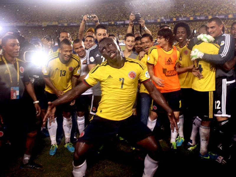 Colombian player Pablo Armero celebrates with teammates after defeating Ecuador 1-0 in their Brazil 2014 FIFA World Cup South American qualifier match, in Colombia. AFP photo