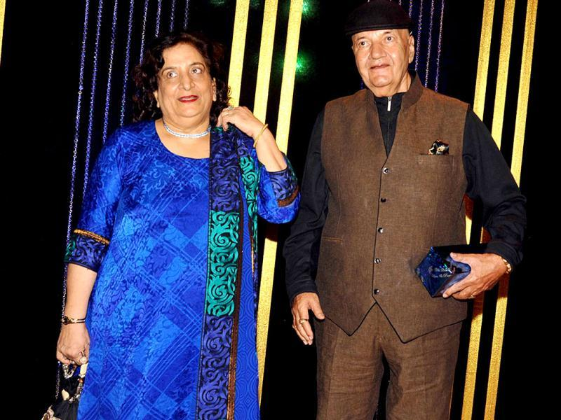 Actor Prem Chopra poses with his wife. (AFP Photo)