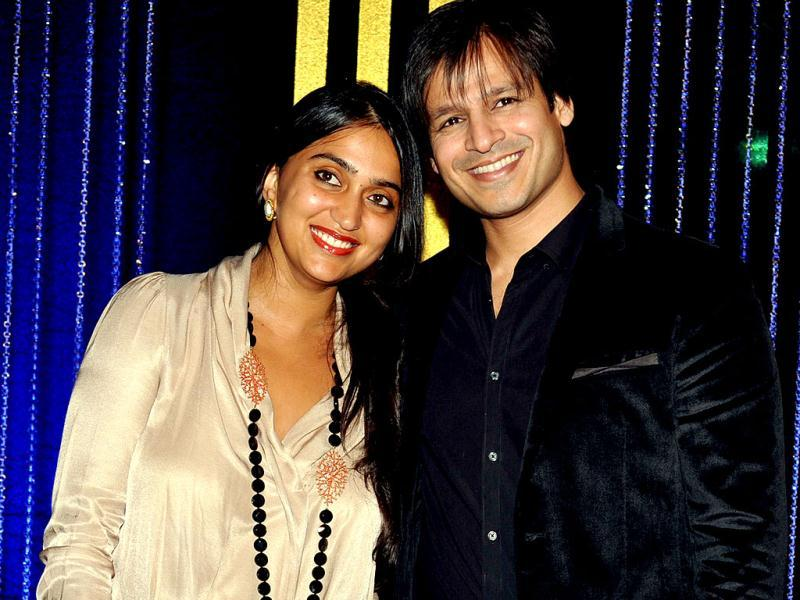 Vivek Oberoi with his wife at the 64th birthday celebrations for Bollywood director Rakesh Roshan in Mumbai on September 6, 2013. (AFP Photo)