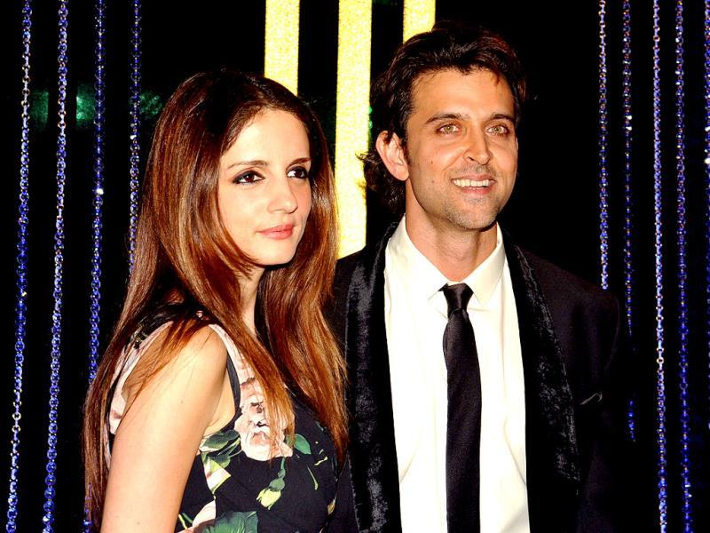 Hrithik Roshan poses with his wife Sussanne at the 64th birthday celebration for his dad Rakesh Roshan. (AFP Photo)