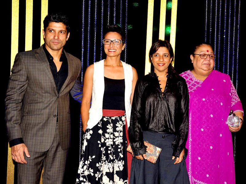 Farhan Akhtar with wife Adhuna, sister Zoya and mother Honey Irani attend the 64th birthday celebrations for Indian Bollywood director Rakesh Roshan in Mumbai on September 6, 2013. (AFP Photo)