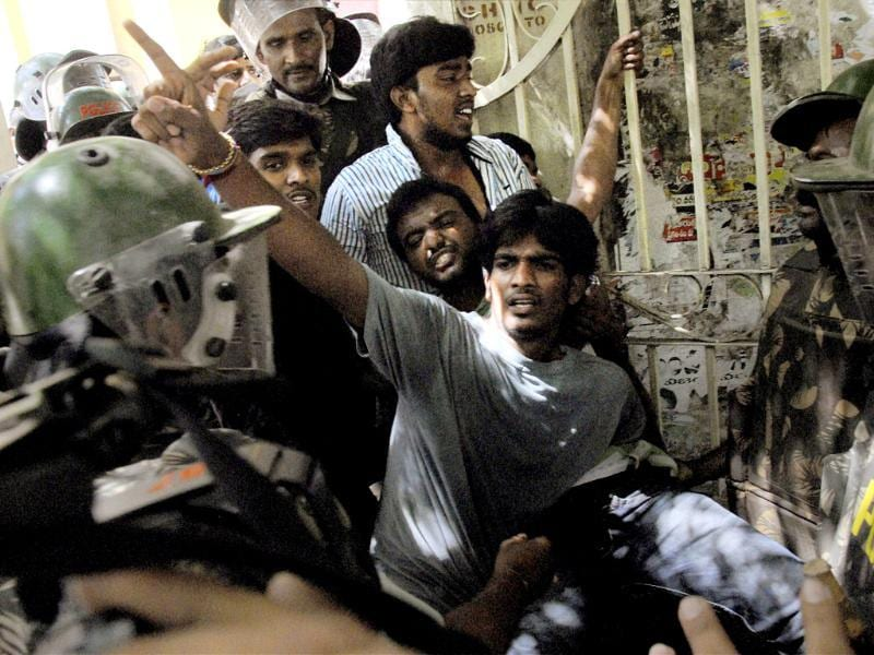 Police detain pro-Telangana Students during a 'Bandh' called by Telangana Joint Action Committee in Hyderabad on Saturday. (PTI Photo)