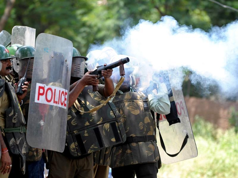 Police fire tear gas rounds against Osmania University students protesting against the 'Save Andhra Pradesh' meeting in Hyderabad. (AFP Photo)