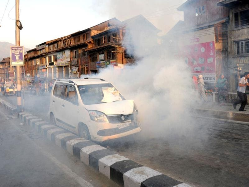 Police throw tear gas towards protesters during a protest against the Ehaas-e-Kashmir music concert in Srinagar. (AFP Photo)