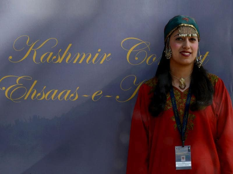 A Kashmiri Muslim wearing a traditional dress looks on before the Ehaas-Kashmir music concert in Srinagar. (AFP Photo)