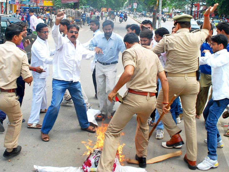 Police in action as Congress workers protest against the Muzaffarnagar riots, burning an effigy of state Chief Minister Akhilesh Yadav, in Allahabad. (PTI Photo)