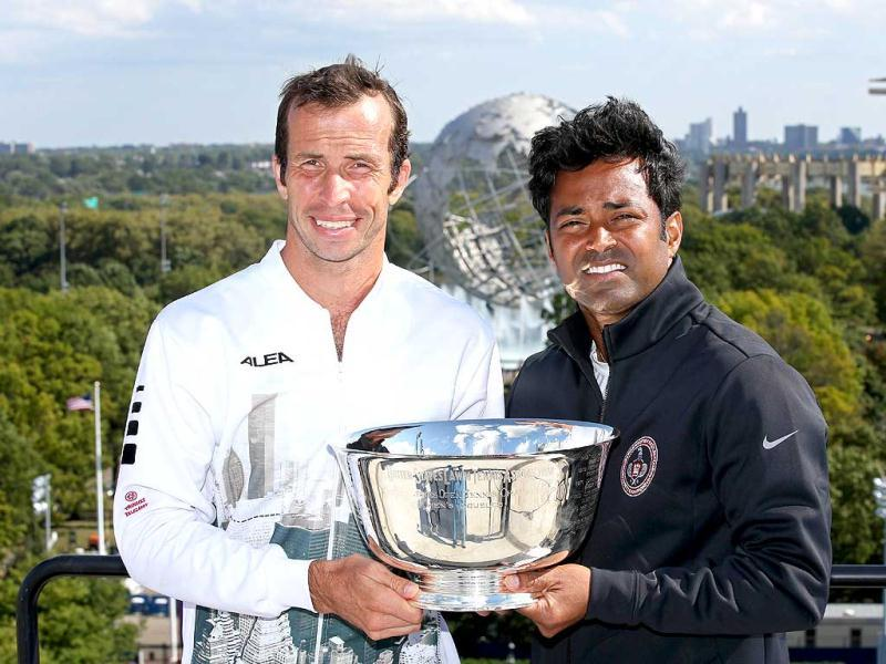 Leander Paes (R) and Radek Stepanek (L) of the Czech Republic pose with their trophy with the of the Unisphere in the background after winning their US Open men's doubles final. (AFP Photo)