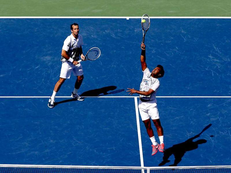 Leander Paes smashes the ball next to his partner Radek Stepanek during their US Open men's doubles final against Alexander Peya and Bruno Soares. (AFP Photo)