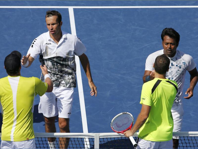 Leander Paes (top, R) and playing partner Radek Stepanek shake hands with Alexander Peya (bottom, L) and Bruno Soares after the former won their US Open men's doubles final match. (Reuters Photo)