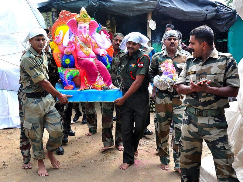 Army soldiers carrying an idol of Lord Ganesh to their batalianon on the occasion of Ganesh Chaturthi in Patiala. (PTI Photo)