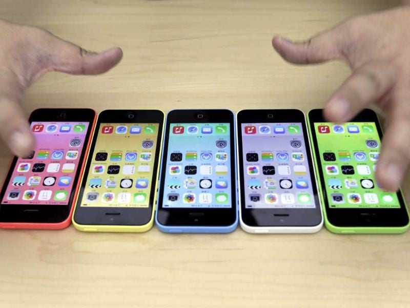 The new iPhone 5C in five colours are placed together at Apple Inc's announcement event in Beijing. (Reuters Photo)