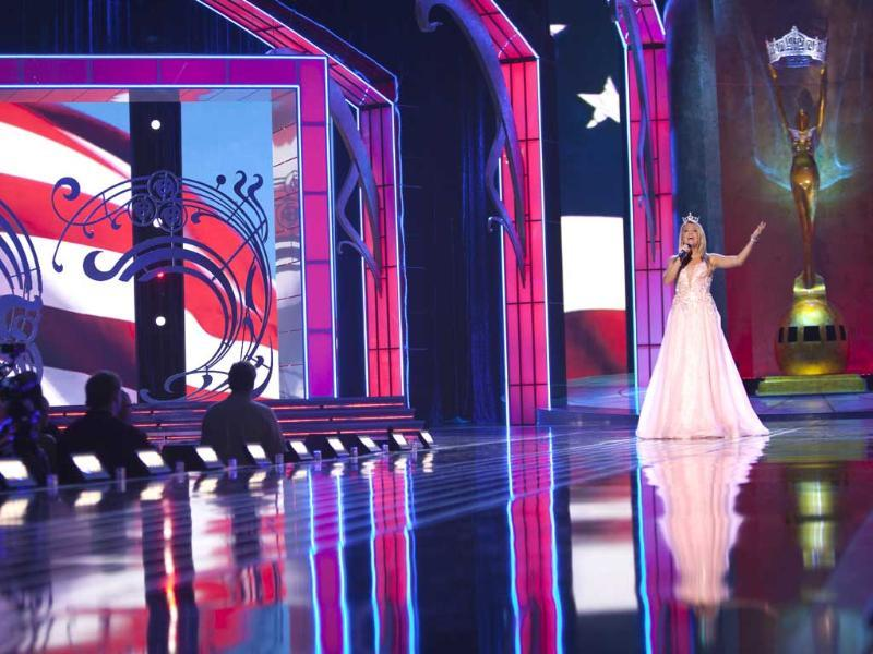 Miss Teen New Jersey Christina Thompson sings the national anthem at the start of the preliminary round of the Miss America pageant in Atlantic City, New Jersey. (Reuters Photo)