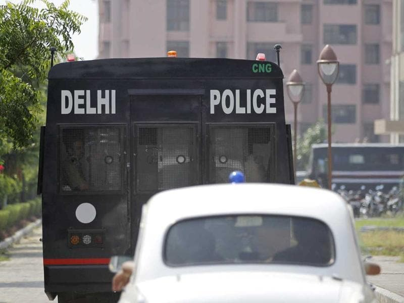 A police vehicle, carrying 4 men convicted in the fatal gang-rape of a young woman on a moving New Delhi bus last year, arrives at a court complex in New Delhi. (AP Photo)